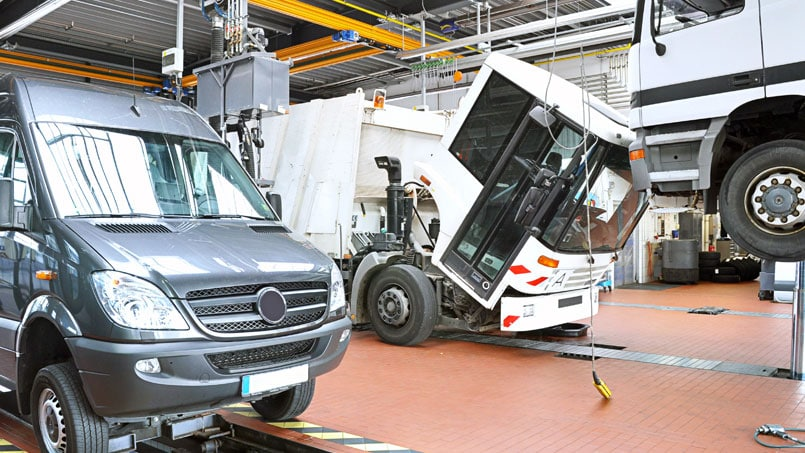 Lorrys and minibus being serviced